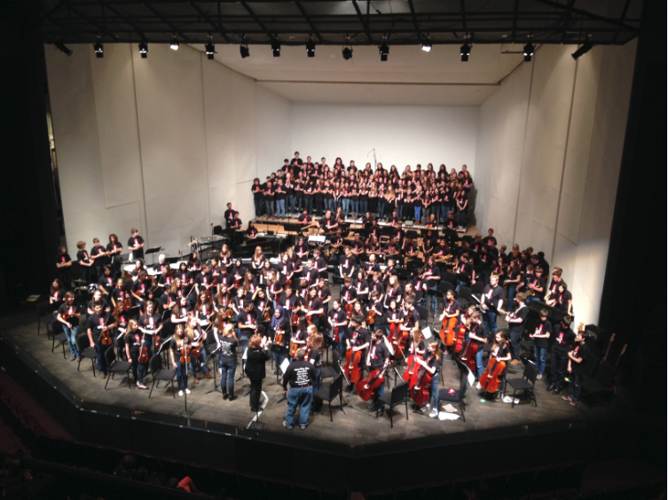 Students+stand+for+applause+at+the+end+of+the+Pops+Concert+on+Dec.+7%2C+2013.+%E2%80%9CIn+general%2C+I+am+very+happy+with+all+of+my+students+this+year.+Everyone+is+working+hard+and+is+doing+their+very+best%2C%E2%80%9D++Upper+School+Orchestra+Director+Englehardt+said.+%0A