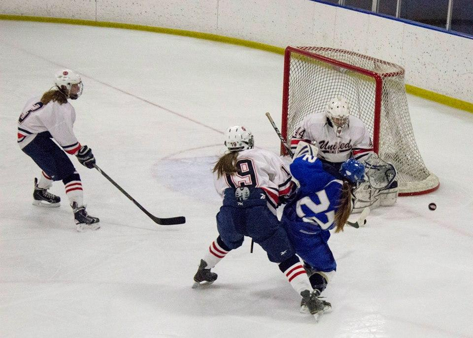 Sophomore goalie Catherine Johnson blocks a shot during a game against Holy Angels Academy and Richfield High School on Dec. 3.