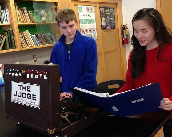 """Science Alliance members junior Brian Heilig and senior Cynthia Zheng practice for the upcoming Science Bowl competition. """"This year we are hoping to build a larger team so we can compete in every event for Science Olympiad and have a strong Science Bowl team,"""" Zheng said."""