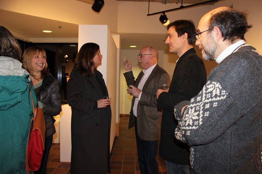 Upper School fine arts teacher Bob Jewett (center) hosts an artist reception on Jan. 30.