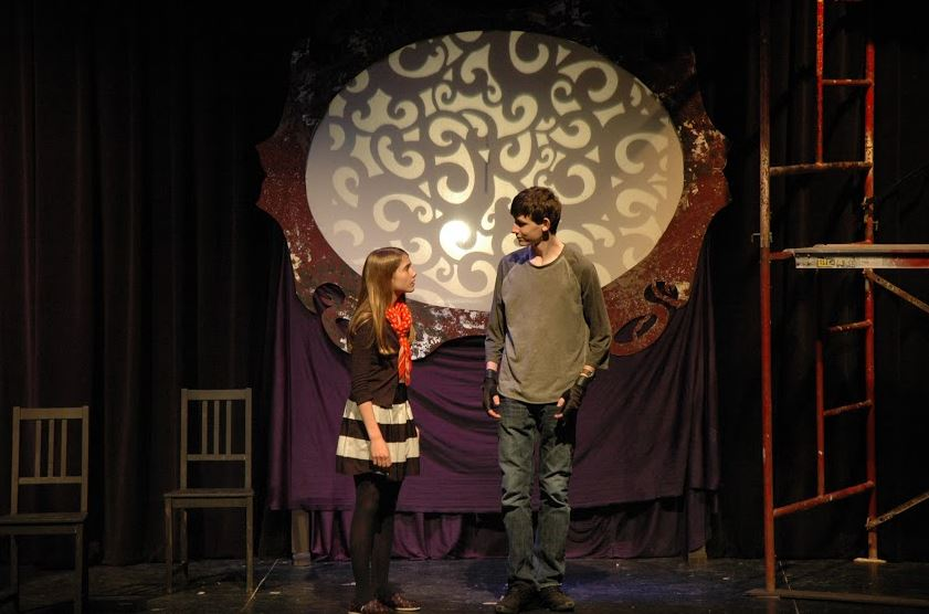 Romans' and Biggs' characters talk, while shadow puppets directed by sophomore Netta Kaplan play on the screen behind them.