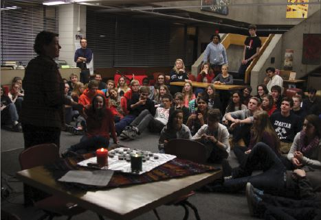 """Upper School Counselor Susanna Short speaks to the sophomore class about togetherness and class cohesion. """"[The sophomore retreat] was a really good way to get to know everyone without forcing a connection,"""" junior Delaney Carter said."""
