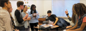 """Seniors Charlie Rosenblum, Ysabella Johnson, Alicia Zhang, juniors Bella Martinez, Evva Parsons, Jesus Vega, Emma Rodgerson, and freshman Lutalo Jones discuss the Martin Luther King Jr. Day assembly. """"It's an experience to talk about it, and keep relearning history and bring in new perspectives,"""" Rosenblum said."""