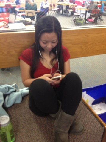 "Senior Helen Derechin quietly uses her phone during a free period. ""I like that it gives us access to communication with other people, especially if we need to contact our parents for some reason or to arrange after school plans,"" she said."