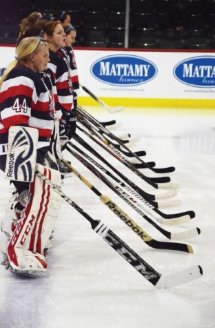 The United Hockey team, with sophomore goalie Catherine Johnson at the front, lines up to head into the semifinals of the Feb. 21 state tournament.