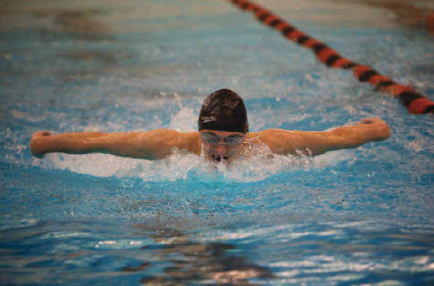 "Sophomore Karsten Runquist does the butterfly stroke at the Jan. 24 meet at Humboldt. ""... we all got into the locker room and start screaming as loud as we could to get pumped up,"" freshman Matt Suzuki said."