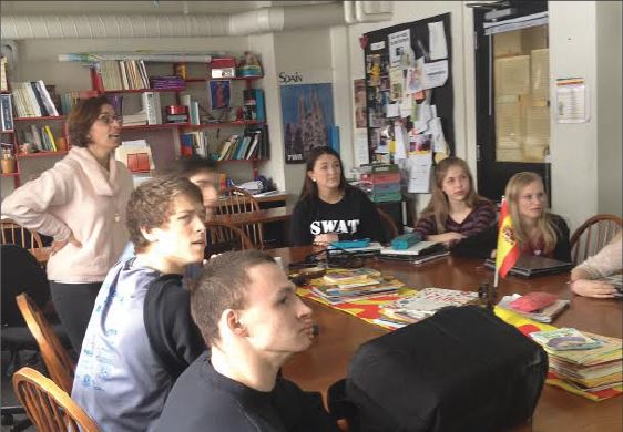 """Spanish V classes prepare for the Language Exam.  From Left:  Karsten Runquist, Kent Hanson, US Spanish teacher Rafaela Salido, Lukas Kelsey-Friedman, Katie Ademite, Mary Naas, and Laura Viksnins review vocabulary.  """"On the curve, we are really there with every other school,"""" Salido said."""