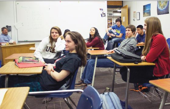 """Members of math team listen to Upper School mathematics teacher Bill Boulger (not pictured) as he explains the upcoming competition. """"As always, Mr. Boulger is absolutely incredible. He's everything the Math Team could want and more,"""" senior captain Vittorio Orlandi said."""