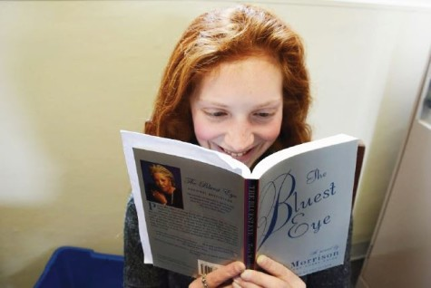 """Senior Grace Owens-Kurtz reads The Bluest Eye, a book by Toni Morrison for her Gender and Literature English class. """"[Reading]'s like when you were a kid, and you played pretend,"""" she said. """"With a book, you can immerse yourself in the world you've always wanted."""""""