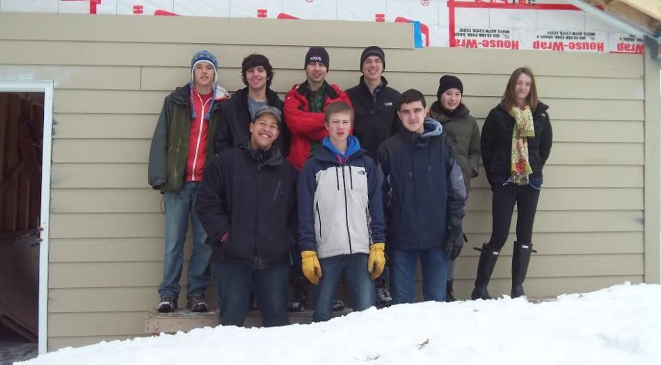 From top left to bottom right, senior Chris Pifer, senior Vittorio Orlandi, senior Philip Swanson, senior Charlie Southwick, junior Amber Skarjune, senior Sam Carlson, junior Carrie Jaeger, junior Kevin Patterson, and junior Thomas Toghramadjian pose for a picture after a hard day of work at one of Habitat for Humanity's St. Paul homes.