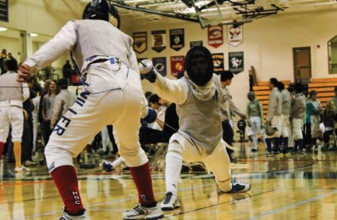 "Sophomore foilist Milo Wittenberg lunges at his Minnesota Sword Club opponent at the state fencing competition on Feb. 22 at Holy Family Catholic High School. ""We have a very good fencing team, especially when you consider the fact that it's so young and new to the sport,"" women's epée team captain Katherine Jones said."