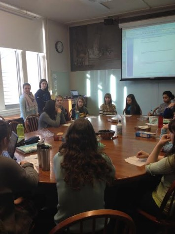 "Students for Social Justice members lead a discussion about the dress code, led by presidents sophomores Alena Porter and Claire Walsh (standing on left). ""We are working with [the Upper School Council] and a group of other [students] to change the dress code,"" Porter said."