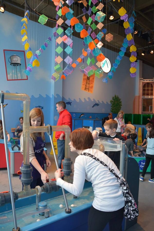 Senior Chloe White, left, volunteers at the Childrens Museum for Service Day.