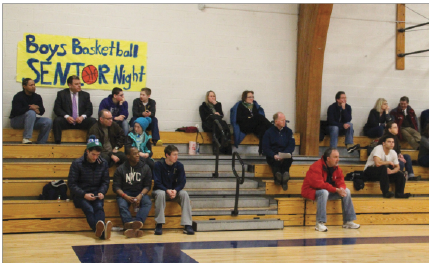 Only a handful loyal Spartan student fans attend the home Girls Varsity Basketball game against Breck on Feb 26. The team lost 50-43.