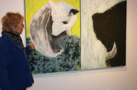 Upper School fine arts teacher Marty Nash stands with one of her pieces in the Harry M. Drake Gallery.