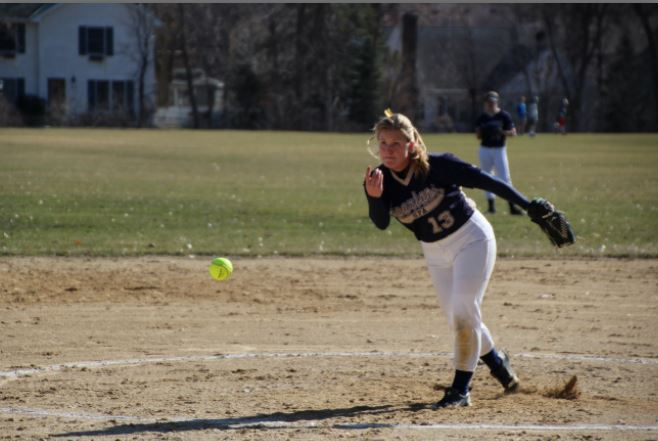 Senior co-captain Alex Miller pitches during the Varsity Softball home game against Highland Park. The team lost 16-18.
