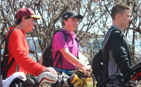 Freshmen Drew and Colin O'Hern and sophomore John Boosalis head off to their golf practice on April 21.