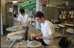 Seniors Connor Allen and Philip Swanson enjoy making new sculptures in the senior art seminar class.