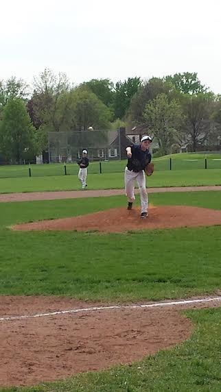Freshman Emerson Egly delivers a pitch in a May 24 section game against Edison High School.