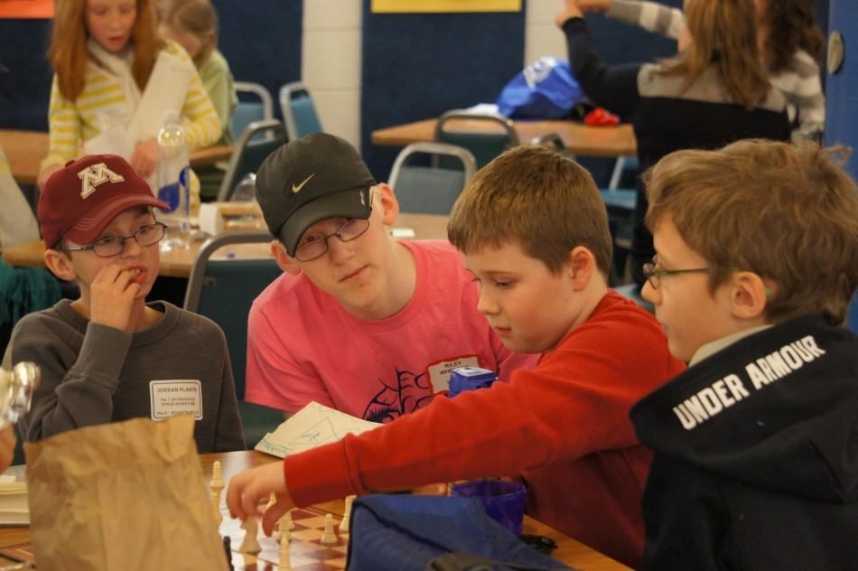 """Sophomore Riley Wheaton supervises aspiring scientists at his weekend job with the Minneapolis Institute for Talented Youth.   """"My job is to go in to help set up and to help the kids if they are having trouble staying focused or staying quiet,"""" Wheaton said."""