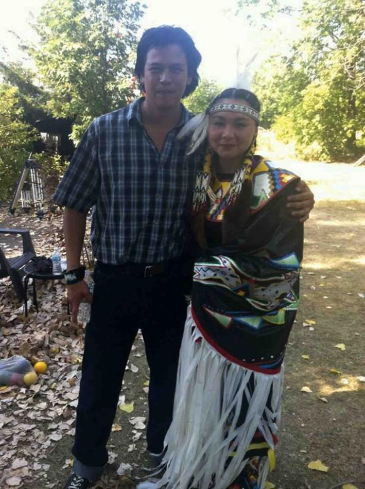 Junior Isabelle LaBlanc poses with actor Chaske Spencer from the Twilight film, who plays the lead in The Jingle Dress.