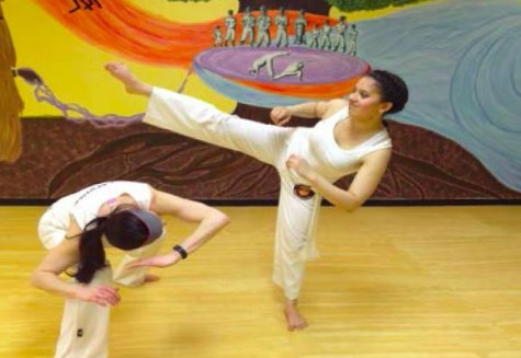 Junior Sandhya Ramachandran practices Capoeira, an Afro-Brazilian  form of martial arts and dance, at the Omulu Capoeira Academy of Minnesota. Ramachandran describes the club as
