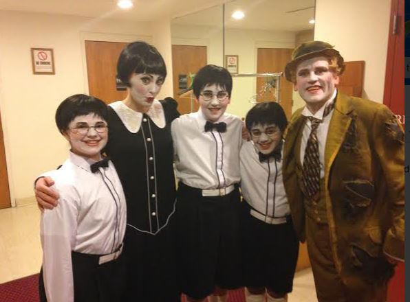 Sophomore Claire Walsh (far left) with other performers in the Minnesota Opera's The Magic Flute. The production broke ticket sales records.