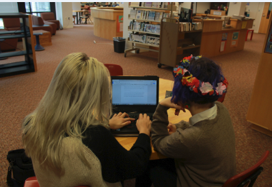"""Sophomore Phoebe Pannier works with sophomore Emily Schoonover on an assignment via Google Drive. """"It's helpful to be able to collaborate with peers on group projects,"""" she said."""