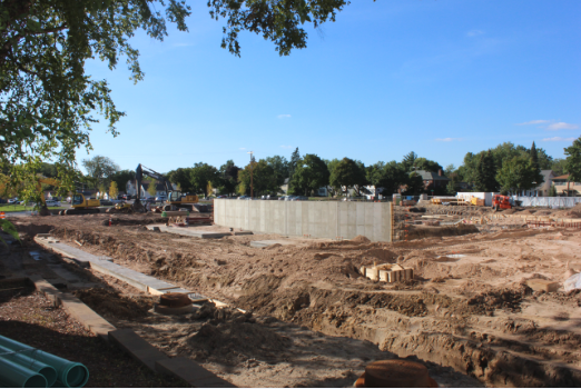 """The Huss Center for the Performing Arts has been under construction on the site of the old Drake Arena parking lot since June of 2014, creating a longer walk for students. The path now goes all the way around Drake arena to get to the Lily Courtyard. """"It's for a good cause so I'm not too bothered by having a little detour,"""" senior Jackson Lea said."""