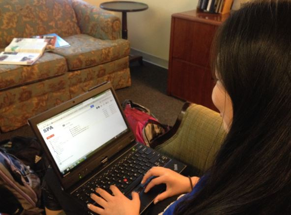 """Sophomore Stephanie Li checks her World History folder in Google Drive after school, working hard to stay organized and keep up with her latest assignments.  """"[Google Drive] is for the most part effective in the classroom… if you're traveling you can't really use it but it's easy for teachers and students to access, it helps with organizations and it saves things automatically so it's more reliable than Word,"""" she said."""