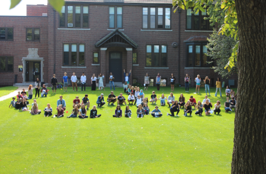 """Students for Social Justice, Intercultural Club, and Poetry Aloud planned an all-student event to recognize the International Day of Peace.  Upper School students on the Randolph Campus assembled on the front lawn Sept. 22 to form a human peace sign for the second year in a row. Senior Bella Martinez read """"No Flowers for Terrorists,"""" by Linda Lerner. Dozens of students joined to honor and observe this day of global peace. """"I had fun reading the poem,"""" Martinez said, """"because it felt significant."""""""