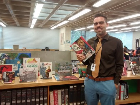 Upper School dean Max Delgado poses with the book