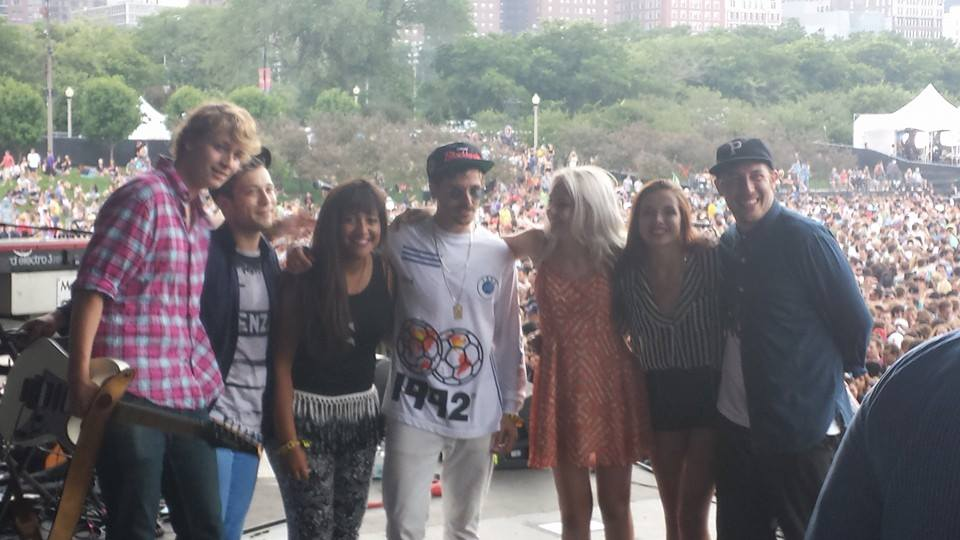 On stage at Lollapalloza, sophomore Emily Schoonover (third from right) poses with members of the band Portugal. The Man and other artists that she had met on tour.