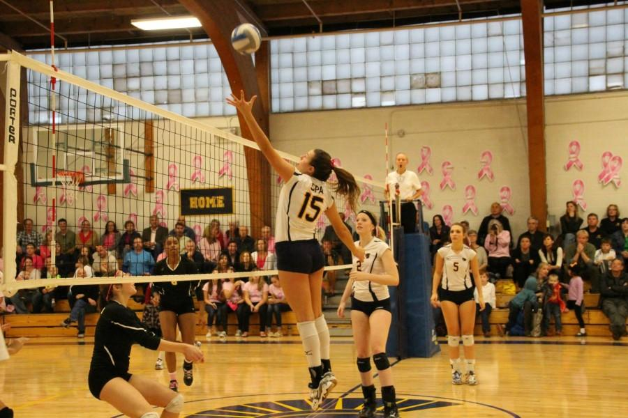 Senior Mira Grinsfelder sets the ball for a spike across the net in the Dig Pink game against DeLaSalle Oct. 10.