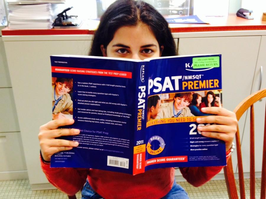 Senior national merit semifinalist Neerja Thakkar browses through a test prep book