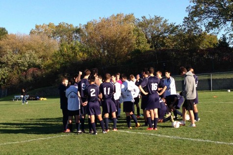 The team regroups at halftime in the game against Como Park. The Spartans lost 1-0.