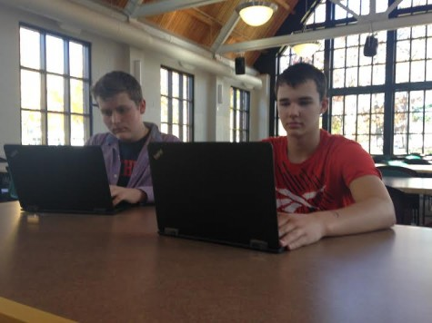 "Freshmen Freddy Keillor and Oscar Millerhaller sit down to take their ImPACT baseline test in   the Dining Hall on Oct. 23. ""It's good that we take this test and I'm glad they make us because it   is more safe,"" freshman Freddy Keillor said."