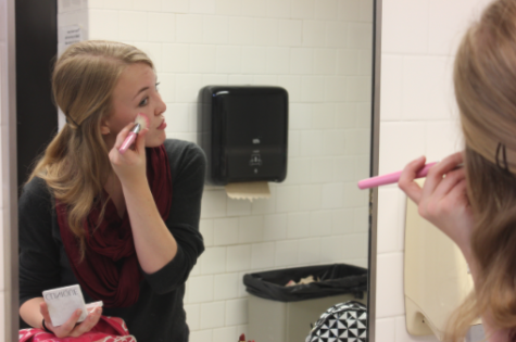 """JUNIOR MIRIAM TIBBETTS demonstrates her own makeup technique. """"Try doing makeup for a show sometime because you get a lot of credit for what you do and [it] is completely necessary for the show. Just remember to have fun,"""" Tibbetts said."""