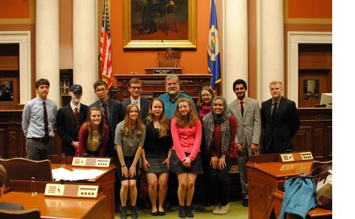 """Debaters line up for a picture at the state capitol. """"It was a little tricky to understand the voices echoing through the mic but we pulled it off.  The setting made things a little more formal, but we all make the choice to go out and dress in suits so we have fun with that stuff,"""" Wheaton said."""