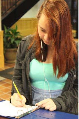 Sophomore isabelle Bukovsan signs in to the building in Davern Commons.  Students who arrive at school before 7:30 or who stay after hours and on weekends must utilize the sign-in sheet.