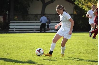 """Sophomore Lauren Hansen dribbles down the field in a game against Richfield on Oct 7. St. Paul Academy and Summit School won 7-0. """"I am grateful for my team and the great season,"""" Hansen said."""