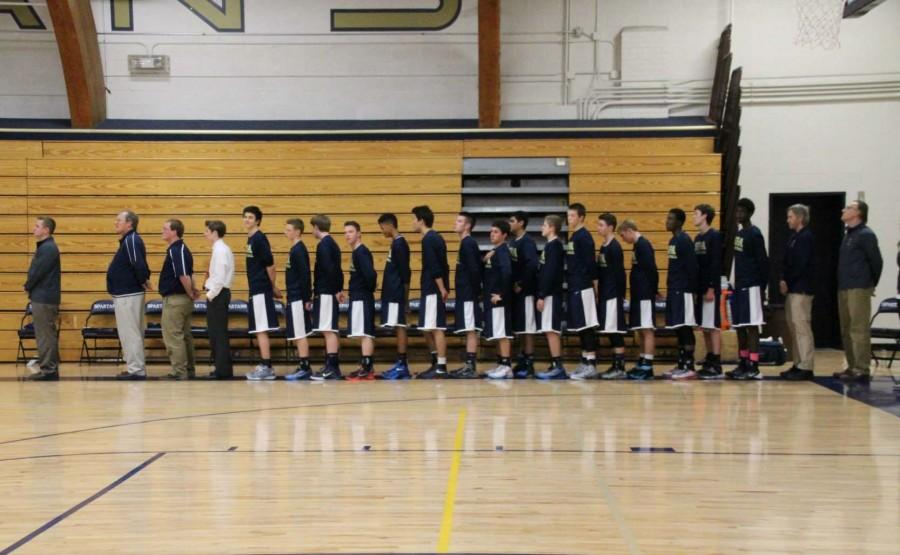 The+Spartan+Varsity+Boys+and+their+coaches+stand+for+The+National+Anthem.