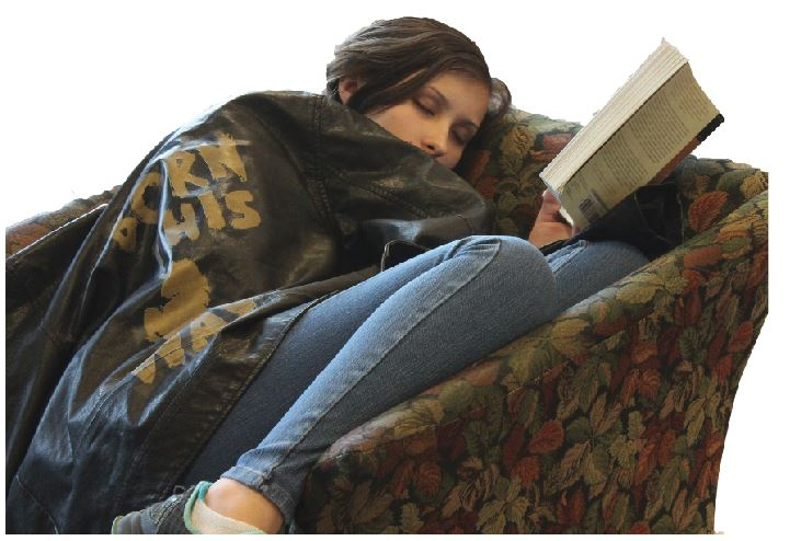 Senior Dani Tiedemann pretends to catch a quick nap in the Summit Center between classes.   Students who suffer from lack of sleep may struggle to stay awake at school and have difficulty paying attention in class, according to the National Sleep Foundation.