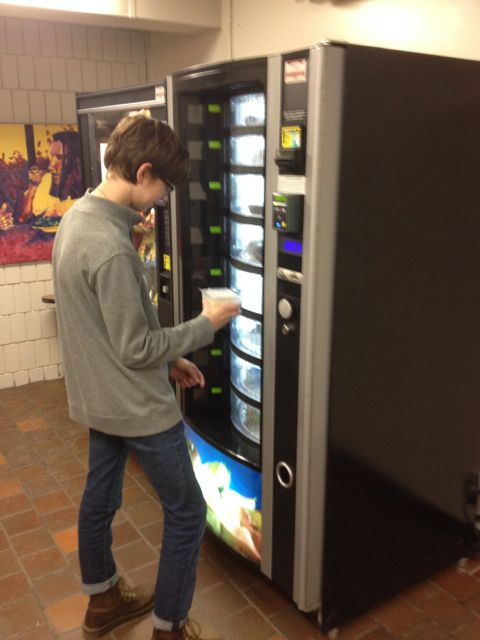 Sophomore Andrew Michel checks out the new vending machines in the athletic hallway.