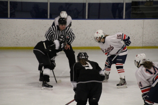 Junior Bridget Hoffmann faces off for the puck in the team's Nov. 29 victory over the Minneapolis Novas.