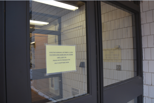 """The main gym doors from lily courtyard closed and locked Oct. 13. The doors will remain locked until 3 pm when they open for the convenience of after school sports. """"We want people to access the school in places where we have safety and security officers or other school employees available to watch,"""" US Principal Chris Hughes said."""