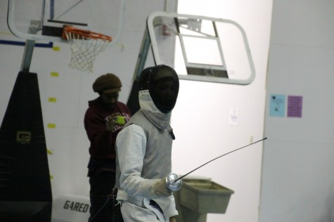 "Sophomore Sal Ciresi participates in a fencing match at  the Twin City Fencing Club during the 2013-14 season. Anybody is welcome because anybody can learn and do well,"" sophomore captain Colin O'Hern said."
