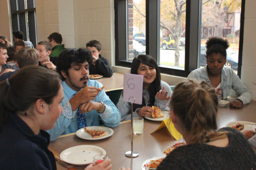 """Table 6 offered these students a space to talk with a group they regularly might not sit with.  """"It's fun. I get to learn new things,"""" freshman Elsa Runquist said."""