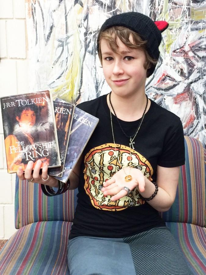 """Junior Alice Tibbetts holds up some of her much-loved Hobbit merchandise. """"I've come to appreciate some of the characters more because of how well they are acted, especially Gandalf and Bilbo,"""" she said."""