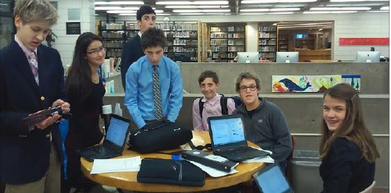 """novice debaters PREP for the State Tournament, in the Upper Library just before leaving for the competition on Dec. 5. """"It was a lot of fun, there were a lot of people there and there was a larger range of competition … there were definitely higher stakes,"""" freshman Henry Zietlow said."""